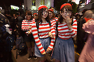 October 29, 2016, Tokyo, Japan: In the Shibuya district, the heart of Japanese youth culture, Halloween celebrations have exploded in the past few years. Up until this boom, Halloween celebrations were minimal across the city. But Shibuya has now become Halloween central with tens of thousands of costumed party goers invading it's streets to promenade en-costume or hit club events in the area. This informal street gathering has become so big, this year the Tokyo Metropolitan Police Dept. decided to close off two main streets adjacent to Shibuya Station. When Oct. 31 falls on a weekday, ninety percent of Halloween celebrations across Japan take place on the preceding Saturday. Pictured here are Where's Waldo costumes.(Torin Boyd/Polaris).