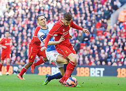 LIVERPOOL, ENGLAND - Sunday, March 8, 2015: Liverpool's Adam Lallana is brought down by Blackburn Rovers' Matthew Kilgallon but no penalty was awarded during the FA Cup 6th Round Quarter-Final match at Anfield. (Pic by David Rawcliffe/Propaganda)