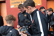 August 9th 2017, Dens Park, Dundee, Scotland; Scottish League Cup Second Round; Dundee versus Dundee United; Dundee United's Thomas Scobbie and Scott McDonald sign autographs as they make the short walk from Tannadice to Dens Park