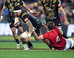 """Vaea Fifita of the Hurricanes, left, is held by Iain Henderson of the Lions in the International rugby match between the the Super Rugby Hurricanes and British and Irish Lions at Westpac Stadium, Wellington, New Zealand, Tuesday, June 27, 2017. Credit:SNPA / Ross Setford  **NO ARCHIVING"""""""