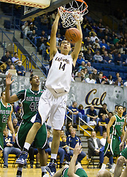 December 28, 2009; Berkeley, CA, USA;  California Golden Bears center Max Zhang (14) dunks past Utah Valley Wolverines forward Justin Baker (45) during the second half at the Haas Pavilion.  California defeated Utah Valley 85-51.