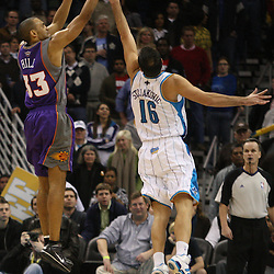 Feb 01, 2010; New Orleans, LA, USA; Phoenix Suns forward Grant Hill (33) shoots over New Orleans Hornets forward Peja Stojakovic (16) during the fourth quarter at the New Orleans Arena.The Suns defeated the Hornets 109-100. Mandatory Credit: Derick E. Hingle-US PRESSWIRE