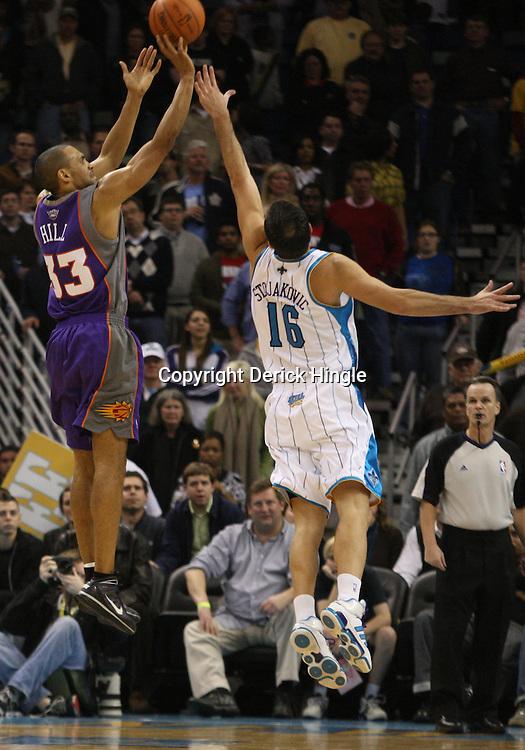 Feb 01, 2010; New Orleans, LA, USA; Phoenix Suns forward Grant Hill (33) shoots over New Orleans Hornets forward Peja Stojakovic (16) during the fourth quarter at the New Orleans Arena.The Suns defeated the Hornets 109-100. Mandatory Credit: Derick E. Hingle-US PRESSWIRE