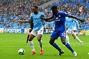 Raheem Sterling (7) of Manchester City battles for possession with Bruno Ecuele Manga (5) of Cardiff City during the Premier League match between Cardiff City and Manchester City at the Cardiff City Stadium, Cardiff, Wales on 22 September 2018.