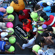 Jo-Wilfried Tsonga, France, signing autographs after his win against Aleksandr Nedovyesov, Kazakhstan, during the US Open Tennis Tournament, Flushing, New York, USA. 28th August 2014. Photo Tim Clayton