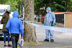 © Licensed to London News Pictures. 28/05/2019. London, UK.Forensic officers on Romford Road, Forest Gate, East London where a man in his 30s died in the early hours of this morning following a flight on Warwick Road.<br />