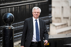 © Licensed to London News Pictures. 26/03/2018. London, UK. Brexit secretary DAVID DAVIS is seen leaving Downing Street in London ahead of a statement to Parliament on last weeks EU summit by British Prime Minister Theresa May. Photo credit: Ben Cawthra/LNP