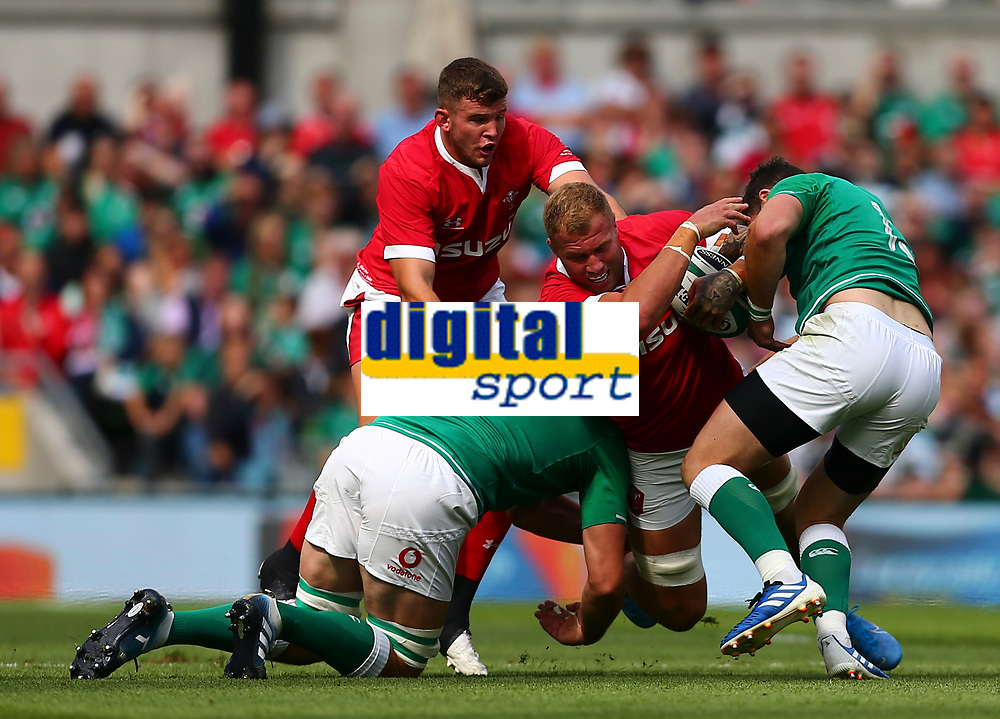 Rugby Union - 2019 pre-Rugby World Cup warm-up (Guinness Summer Series) - Ireland vs. Wales<br /> <br /> Ross Moriarty (Wales) is tackled by Jean Kleyn (Ireland) and Robbie Henshaw (Ireland) at The Aviva Stadium.<br /> <br /> COLORSPORT/KEN SUTTON