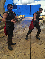 "EXCLUSIVE: WEB EMBARGO UNTIL 1am PST ON Nov 3 Chris Hemsworth's stunt double has given an exclusive behind the scenes look at his time on the set of Thor: Ragnarok to coincide with the release of the Marvel blockbuster. Opening up his personal photo diary taken while on location in Australia's Gold Coast, British-born stunt master Bobby Holland Hanton talks long days on set with Hemsworth and how he's become the Aussie star's go-to stuntman and good friend having worked together for the past six years. Bobby, 33, also revealed one of his rigorous training sessions at his local London gym — where the former gymnast put on an impressive stunt routine including back flips and somersaults — before he headed out to Atlanta in September to start filming the fourth Avengers movie, where he will again double for Hemsworth as Thor. And judging by Bobby's rippling six-pack and bulging biceps, the rigorous regime he has to endure to match up to the God Of Thunder has paid off. But by his own admission, keeping up with 34-year-old Chris is no easy feat. Bobby explained: ""He's in ridiculous shape - Chris is very athletic and naturally has a lot of lean muscle mass. He's bigger than me and I have to work hard to keep up with him. ""Before we start filming a movie together, we're in touch regularly so I can see where he's at and so I can maintain the same shape as him."" Bobby's strict fitness plan includes working out twice a day, six days a week for between 45 minutes to 90 minutes, curling 27kg dumbbells to pump up his arms and eating eight monster-size meal every day. Of course, the types of foods he can eat are strictly regulated to those that are high in protein (lots of chicken, turkey, steaks and eggs) and only ""good carbs"" (brown rice, quinoa, sweet potatoes) and ""good fats"" (avocado, olive oil and natural nuts). And eating like Thor sure gives his wallet a bit of a hammering. ""I spend around £250 a week on food, just for me"" expla"