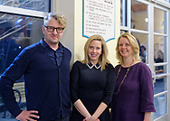 Garden City, New York, USA. March 9, 2019.  L-R, artist MICHAEL WHITE, Hempstead Town Supervisor LAURA GILLEN, and Nassau County Legislator DEBRA MULÉ pose after Unveiling Ceremony of White's mural of Nunley's Carousel horse. Event was held at historic Nunley's Carousel in its Pavilion on Museum Row on Long Island. After speeches by elected officials and members of Baldwin Civic Association and Baldwin Historical Society, and others, people enjoy free carousel rides and food.