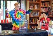 Scienceteller Taylor Darden (left) and volunteer Logan Cole (right) react after Taylor lit ethanol that was in the water bottle during the Sciencetellers show Thursday July 23, 2015 at the Union Library in Hatboro, Pennsylvania. Sciencetellers teach science to their audience by telling a lively, interactive and exciting story intertwined with basic science principles. (Photo by William Thomas Cain)