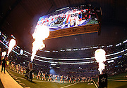 The gigantic overhead television screen shows the pregame festivities on the field as flames shoot up in the air before the Dallas Cowboys NFL week 8 regular season football game against the Washington Redskins on Monday, Oct. 27, 2014 Arlington, Texas. The Redskins won the game 20-17 in overtime. ©Paul Anthony Spinelli