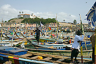 The Port of Elmina, with in the background Elmina's Castle. One of the about forty Slave Castles built along the Coast where the horrific slave trade took place.<br />