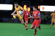 Mark Randall of Newport county (l) is challenged by Scott Wooton of MK Dons &reg;.EFL cup, 1st round match, Newport county v Milton Keynes Dons at Rodney Parade in Newport, South Wales on Tuesday 9th August 2016.<br /> pic by Andrew Orchard, Andrew Orchard sports photography.