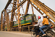 02 APRIL 2012 - HANOI, VIETNAM: The Hanoi to Hai Phong Express Train crosses the Red River on the Long Bien Bridge in Hanoi, the capital of Vietnam.    PHOTO BY JACK KURTZ