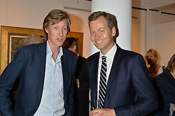 Left to right, BEN HOLLAND-HIBBERT and ? at a reception to celebrate the publication of Hockney - A Pilgrim's Progress by Christopher Simon Sykes held at Sotheby's, New Bond Street, London on 30th September 2014.