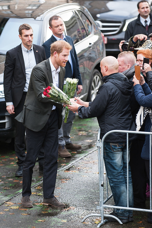 25.10.12017. Copenhagen, Denmark.  <br /> Prince Harry takes a bouquet of flowers from one of the many people waiting for him on arrival at KPH Projects in Copenhagen.<br /> Photo: © Ricardo Ramirez