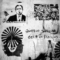 Translation: &quot;TA-TE-TI DEATH FOR YOU&quot; (L) &quot;A FEW STUPIDITIES WRITTEN IN FRENCH &quot;(R)<br /> <br /> Buenos Aires, Argentina March 2006<br /> Protest, resistance and memory:  The Stencil images in Buenos Aires. <br /> The stencil art takes the streets of the Argentinian capital. Urban artists bomb in silence the city with messages that combine political and social content, imagination and irony.<br /> Photo: Ezequiel Scagnetti