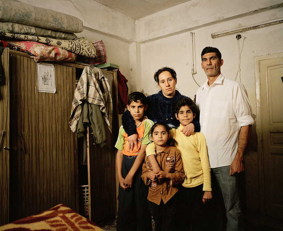 Fatin, 30, and Samir, 44, with three of their four children in the bedroom of their two-room apartment in Amman, Jordan<br /> <br /> &copy;2007-2011 Lori Grinker<br /> All Rights Reserved