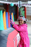 Shekina Samson, 5 , enjoying the fun being put on for her at the Olympic Torch Relay passes through Hatfield, Herts,
