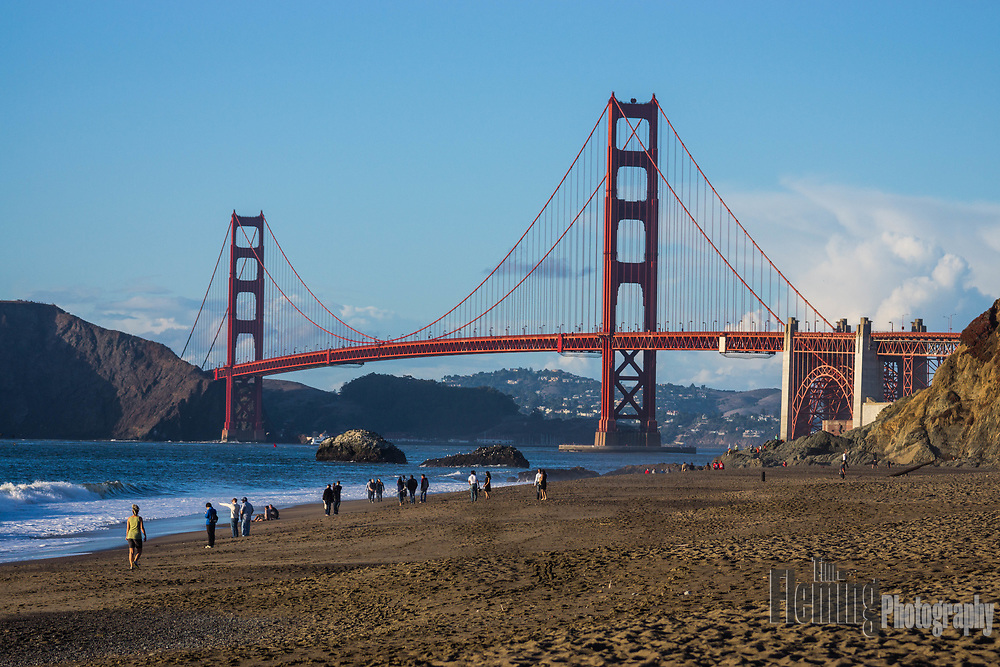 People enjoying Baker Beach on a clear afternoon in San Francisco.