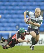 2004/05 Zurich Premiership Rugby - London Irish v Worcester Warriors.Exiles Mark Mapletoft, avaids the diving tackle from Warriors Phil Murphy..07.11.2004 Photo  Peter Spurrier. .email images@intersport-images.com...