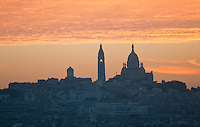 Paris, view across the city to  Sacre Coeur and Montmartre just before dawn.