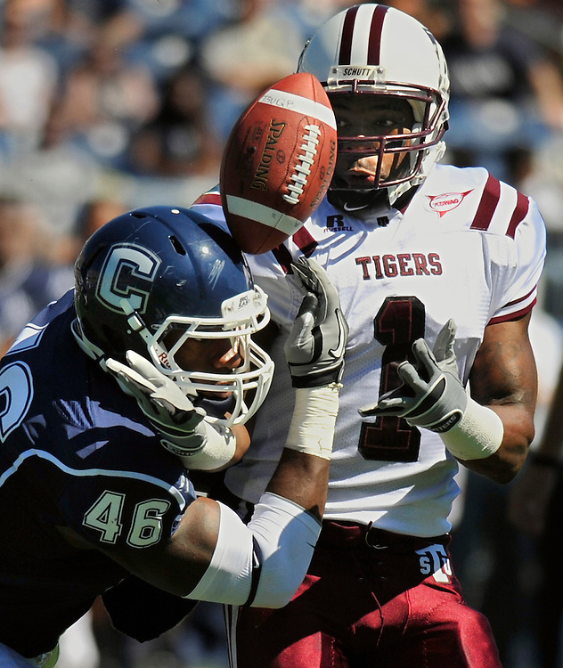 Connecticut's Sio Moore (46) attempts to grab a pass intended for Texas Southern's Joe Anderson, right, during the first half of an NCAA college football game in East Hartford, Conn., Saturday, Sept. 11, 2010.  (AP Photo/Jessica Hill)