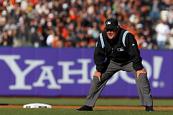 June 12, 2011; San Francisco, CA, USA;  MLB umpire Tim Tschida (4) stands in front of second base during the fourth inning between the San Francisco Giants and the Cincinnati Reds at AT&T Park. San Francisco defeated Cincinnati 4-2.