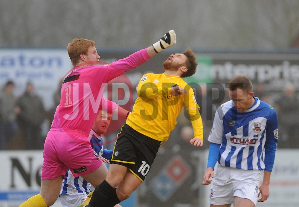Nuneaton Town's Christian Dibble gives Bristol Rovers' Matty Taylor a straight right !! - Photo mandatory by-line: Neil Brookman/JMP - Mobile: 07966 386802 - 04/01/2015 - SPORT - football - Nuneaton - James Parnell Stadium - Nuneaton Town v Bristol Rovers - Vanarama Conference