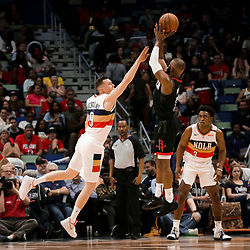 Mar 24, 2019; New Orleans, LA, USA; Houston Rockets guard Chris Paul (3) shoots over New Orleans Pelicans guard Dairis Bertans (9) during the second half at the Smoothie King Center. Mandatory Credit: Derick E. Hingle-USA TODAY Sports