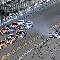 Dale Earnhardt Jr. (88) spins out on the fronstretch during the 58th Annual NASCAR Daytona 500 auto race at Daytona International Speedway on Sunday, February 21, 2016 in Daytona Beach, Florida.  (Alex Menendez via AP)