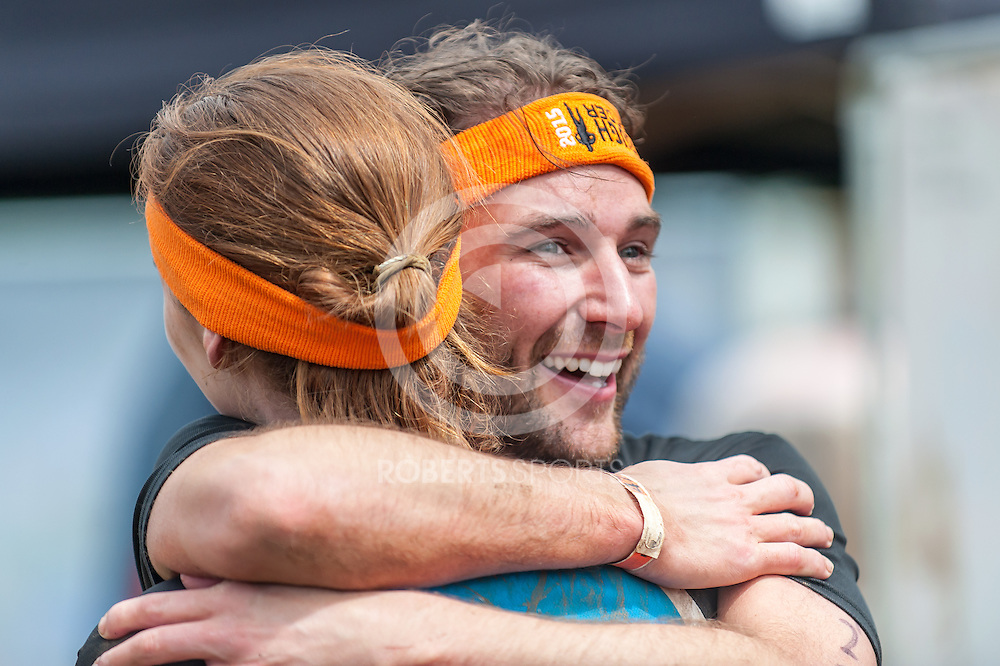Finishers embrace at the end of Tough Mudder Scotland at Drumlanrig Castle in Thornhill, 20 June 2015. (c) Paul J Roberts / Sportpix.org.uk