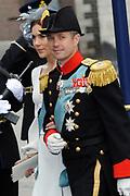 De gasten en koninklijk paar verlaten de kerk na de inhuldiging, Nieuwe Kerk in Amsterdam. <br /> <br /> Guest and Royal couple leave after the inauguration at the Nieuwe Kerk in Amsterdam. <br /> <br /> Crown Prince Frederik and his wife Princess Mary of Denmark
