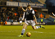 Millwall FC Midfielder Shane Ferguson scores his second of the game during the Sky Bet League 1 match between Millwall and Colchester United at The Den, London, England on 21 November 2015. Photo by Andy Walter.