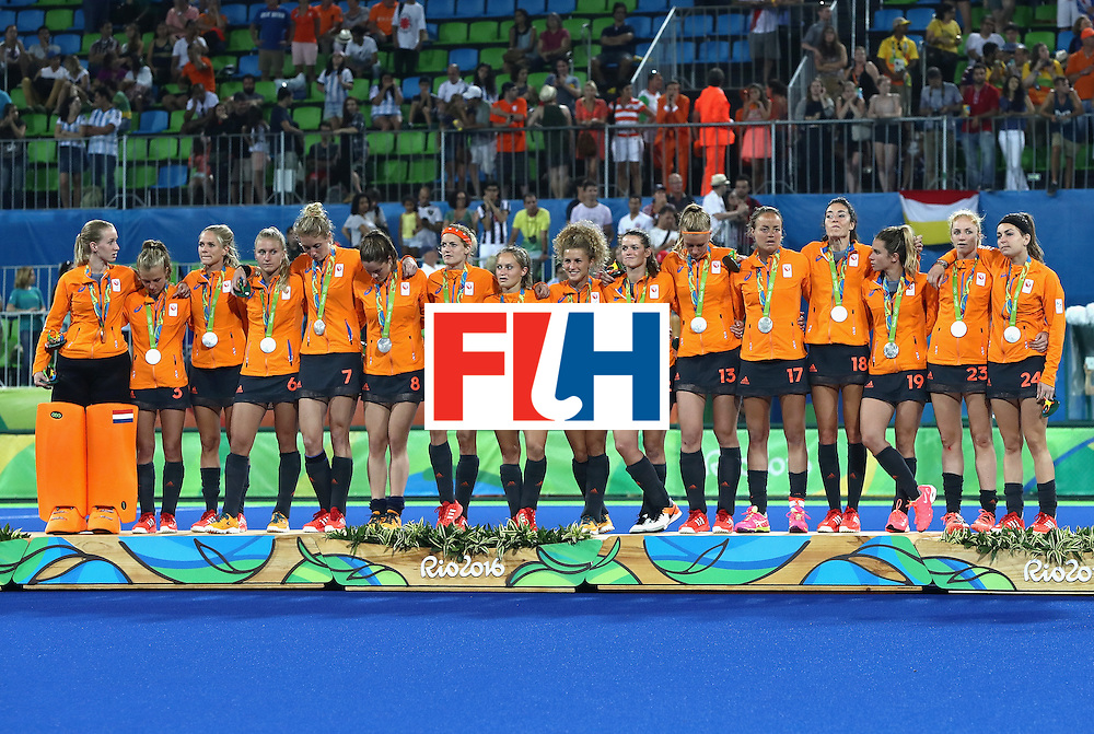 RIO DE JANEIRO, BRAZIL - AUGUST 19:  Netherlands pose on the podium during the medal ceremony after winning Silver in the Women's Hockey on Day 14 of the Rio 2016 Olympic Games at the Olympic Hockey Centre on August 19, 2016 in Rio de Janeiro, Brazil.  (Photo by David Rogers/Getty Images)