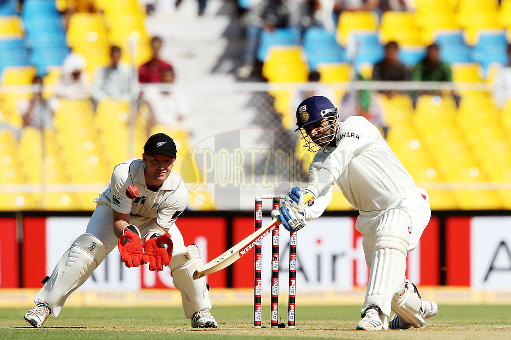 Virender Sehwag knocks a four during day 1 of the first test match between India and New Zealand  held at the Sardar Patel Gujarat Stadium in Ahmedabad on the 4th November 2010..Photo by Ron Gaunt/BCCI/SPORTZPICS