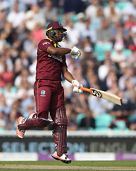 West Indies' Evin Lewis celebrates his century during the Fourth Royal London One Day International at the Kia Oval, London.