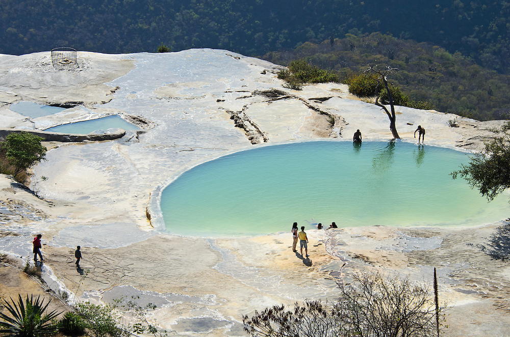 Locals and tourists gather at the mineral pools of Hierve el Agua, in a remote region of the state of Oaxaca, Mexico.