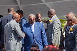 Governor Kenneth Mapp shakes hands with Senator Myron D. Jackson.  Behind him, Lt. Governor Osbert Potter with Senator Neville A. James.  St. Thomas Swearing-In Ceremony for the 32nd Legislature of the US Virgin Islands.  Emancipation Garden.  St. Thomas, VI.  9 January 2017.  © Aisha-Zakiya Boyd