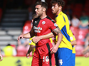 Accrington Stanley midfielder Matt Crooks gets to grips with Crawley Town central defender Jon Ashton during the Sky Bet League 2 match between Crawley Town and Accrington Stanley at the Checkatrade.com Stadium, Crawley, England on 26 September 2015. Photo by Bennett Dean.