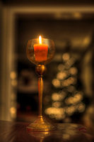 Candle in glass holder at Christmas.