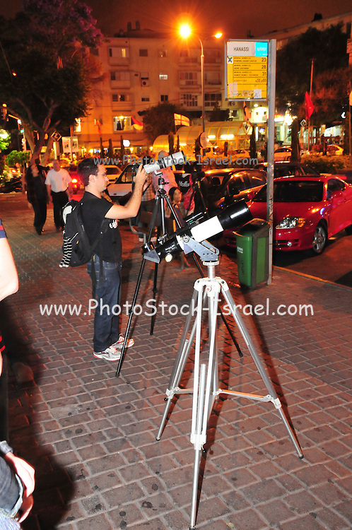 On June 15th 2011 a full moon eclipse was visible. Spectators and photographers photographing this natural event. Photographed in Haifa, Israel