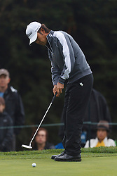 Feb 11, 2012; Pebble Beach CA, USA; Kevin Na putts on the third hole during the third round of the AT&T Pebble Beach Pro-Am at Pebble Beach Golf Links. Mandatory Credit: Jason O. Watson-US PRESSWIRE
