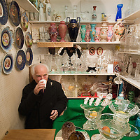 LONDON, ENGLAND - JANUARY 16:  Mr Plaschkes at his stall inside the Roger's Gallery in Portobello Road on January 16, 2010 in London, England. Portobello traders fear for the Market's future after Lipka's Antiques Arcade, where more than 150 traders had their stalls, was redeveloped to accommodate a large High street chain store.  (Photo by Marco Secchi/Getty Images)