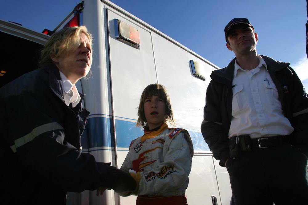 A young go kart driver that was involved in a kart accident in the International Karting Federation race in Primm get first aid from a paramedic that located on the race track. Nevada on Saturday march 3 .2007.....