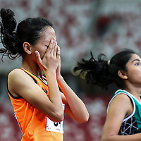 Ismi Zakiah (#34) of Singapore Sports School reacts after winning the A Division girls' 100m final. (Photo © Lim Yong Teck/Red Sports)