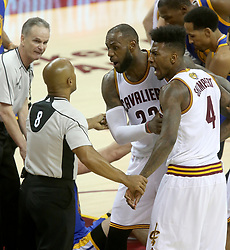 The Cleveland Cavaliers' LeBron James and Iman Shumpert (4) make their case with officials after Shumpert caught a blow to the groin from the Golden State Warriors' Zaza Pachulia in the third quarter during Game 4 of the NBA Finals at Quicken Loans Arena in Cleveland on Friday, June 9, 2017. The Cavs won, 137-116, trimming their series deficit to 3-1. (Photo by Phil Masturzo/Akron Beacon Journal/TNS) *** Please Use Credit from Credit Field ***