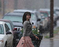 Lauren Dayan takes pictures as snow falls in Oxford, Miss. on Sunday, March 21, 2010.