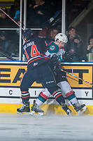 KELOWNA, CANADA - MARCH 25: Nic Holowko #14 of the Kamloops Blazers checks Gordie Ballhorn #4 of the Kelowna Rockets into the boards during second period on March 25, 2017 at Prospera Place in Kelowna, British Columbia, Canada.  (Photo by Marissa Baecker/Shoot the Breeze)  *** Local Caption ***